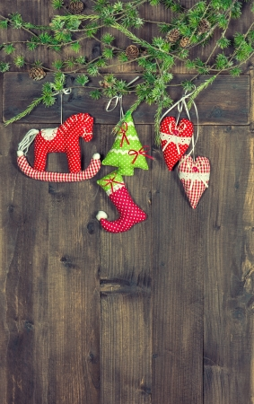 old fashioned christmas: christmas decoration textile handmade toys over rustic wooden background. nostalgic picture with retro style design