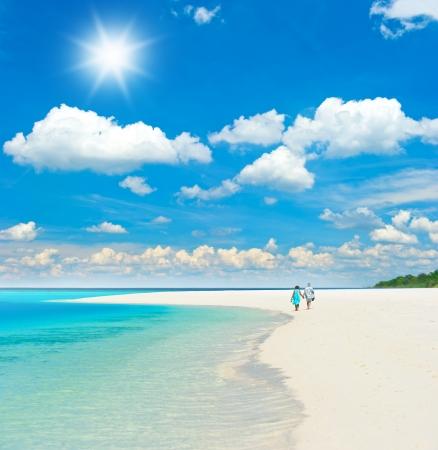 beautiful tropical landscape. senior couple walking on the beach photo