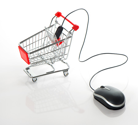 Internet online shopping concept. computer mouse and cart Stock Photo - 24251500