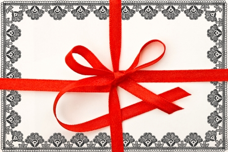 gift card with red ribbon and floral lace frame photo