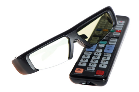 3dtv: 3d glasses and tv remote control on white background Stock Photo