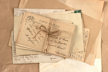 old letters and french postcards. vintage background photo