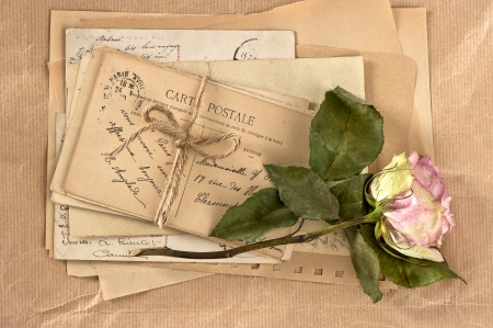dry rose and old letters. vintage postcards and envelopes photo