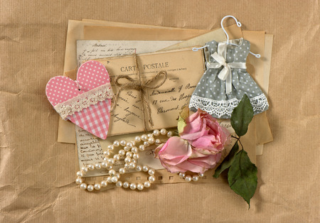 old post cards, flower, heart and perls necklace  vintage background