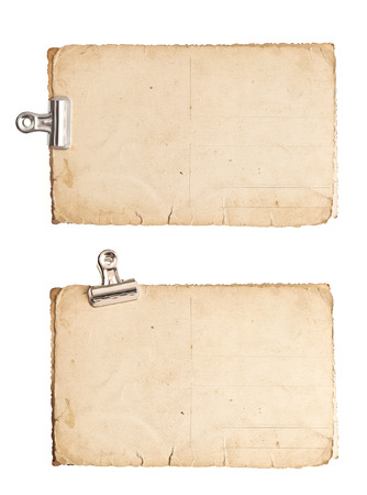 old blank paper photo sheets with clip isolated on white background photo