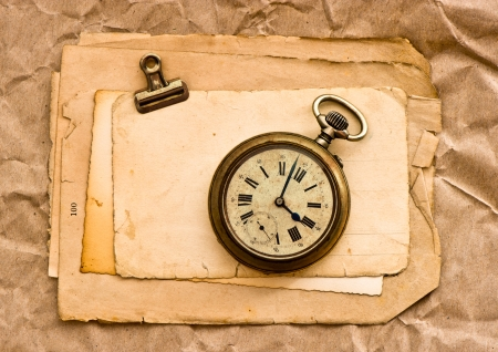 old blank paper sheets with clip and vintage clock photo