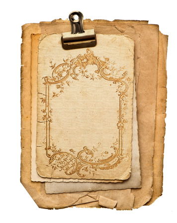old blank paper sheets with golden ornament isolated on white background photo