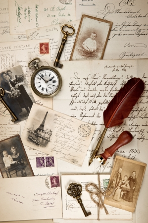 quill pen: nostalgic vintage background with old post cards, letters and photos  collage  artwork