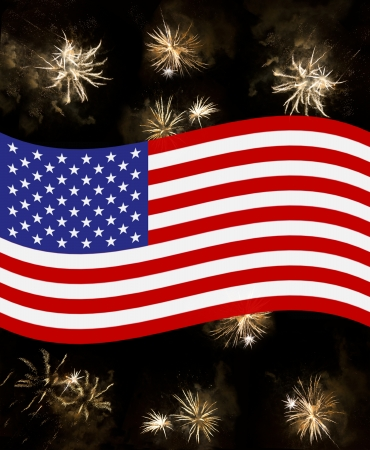 prosit: american flag waving over july 4th fireworks  beautiful golden fireworks exploding over a dark night sky Stock Photo