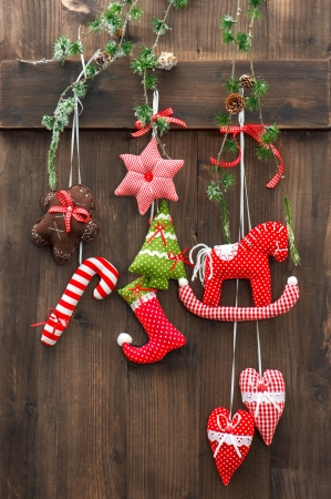 accessories horse: handmade christmas decoration hanging over rustic wooden background  sentimental nostalgic retro style picture
