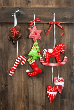 christmas decoration handmade toys hanging over rustic wooden background  nostalgic retro style picture photo