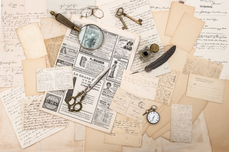 antique accessories, old letters and postcards, vintage ink pen nostalgic sentimental background ephemera and newspaper