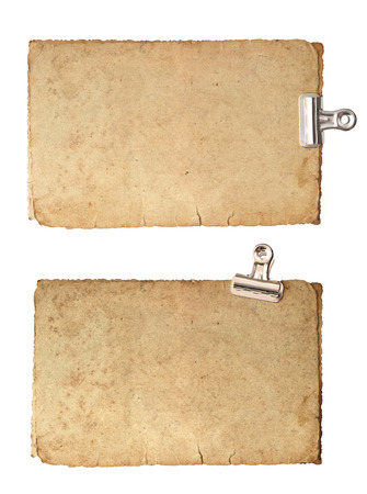 old blank paper sheets with metal clip isolated on white background photo