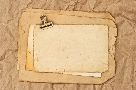 album greetings: old blank paper and photo sheets with clip  grunge background Stock Photo