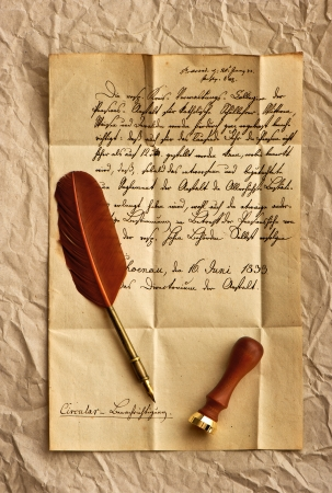 old letter with feather quill and wax seal  vintage background