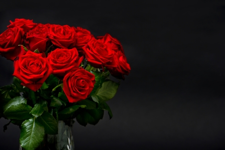 birthday flowers: red roses on black background  festive arrangement Stock Photo