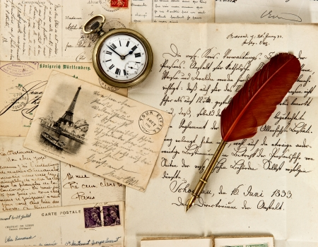 feather pen: old letter and post cards with feather quill and wax seal  vintage background