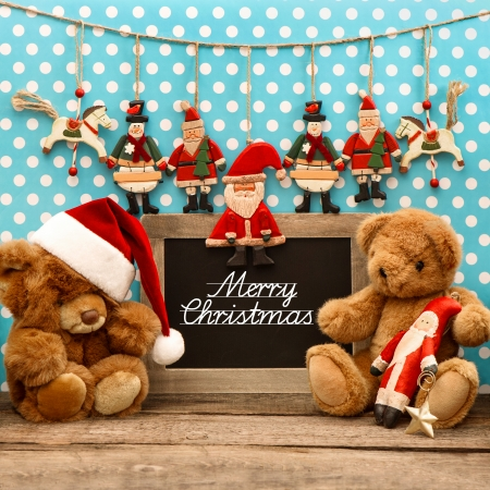 nostalgic home christmas decoration with antique toys  vintage arrangement  and blackboard with sample text Merry Christmas photo