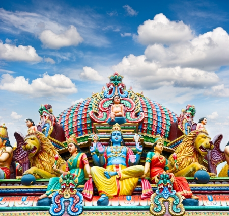 indian god: Detail of Sri Mariamman temple in Singapore over beautiful blue sky