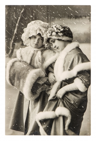 BERLIN, GERMANY - CIRCA 1910  two young girls in vintage winter clothing  retro picture ca  1910, in Berlin, Germany