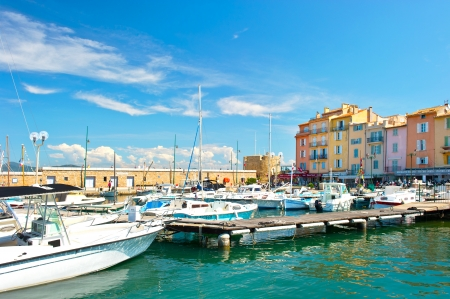 mediterranean landscape with boats and old buildings in harbor of Saint Tropez