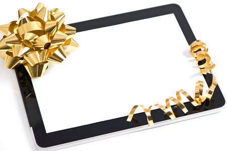 tablet pc golden bow and ribbon decoration  gift concept  with place for your text photo