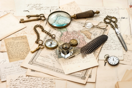antique accessories, old letters and maps, vintage ink pen  nostalgic sentimental journey background  ephemera photo