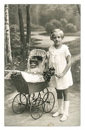 BERLIN, GERMANY - CIRCA 1930  old photo of little girl with doll toy  nostalgic vintage picture from ca  1930, in Berlin, Germany