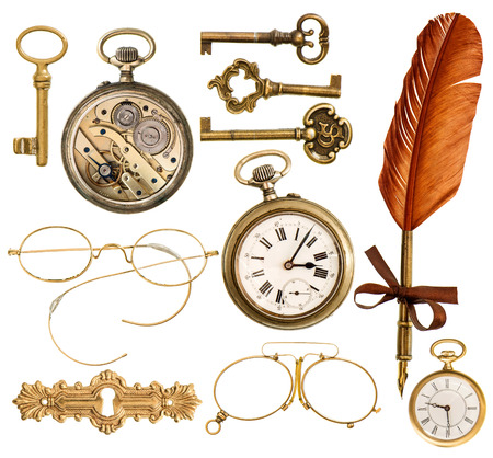 flea: set of golden antique objects  old keys, clock, ink feather pen, nostalgic glasses isolated on white background Stock Photo