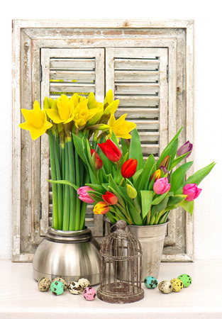 decoration with fresh spring flowers and colored easter eggs photo