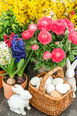 spring flowers with easter home interior decoration photo