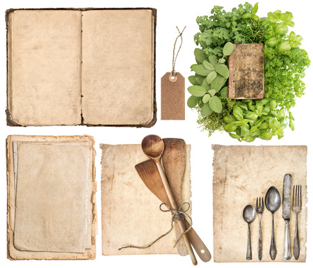 Antique wooden kitchen utensils, old cookbook, pages and herbs isolated on white background photo