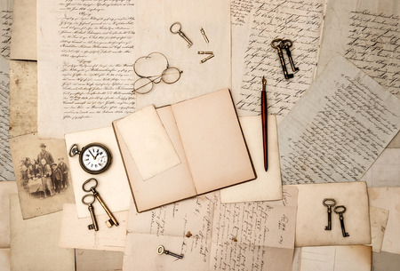 old letters: open book, vintage accessories, old letters and post cards Stock Photo