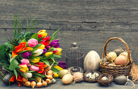 easter decoration with eggs and tulip flowers photo