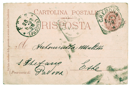 unreadable: postcard  old used italian handwritten letter with typical for this time stamps and paper texture  text unreadable Stock Photo