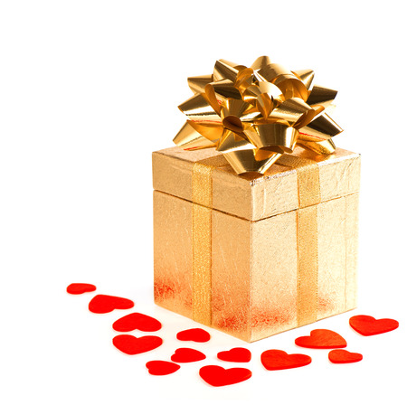 golden gift box with bow and red hearts decoration on white background photo