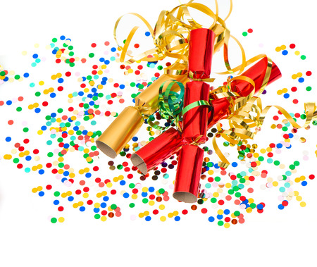 party popper: party cracker, golden streamer and confetti over white  festive decoration