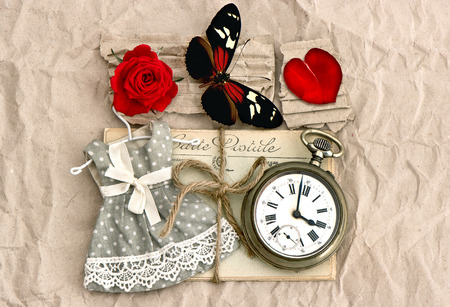old love post cards and vintage clock, red rose flower, valentine heart and butterfly  nostalgic romantic  photo