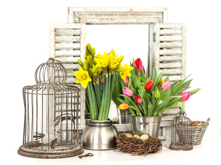 tulips and narcissus bouquet  home interior with fresh spring flowers and easter eggs photo