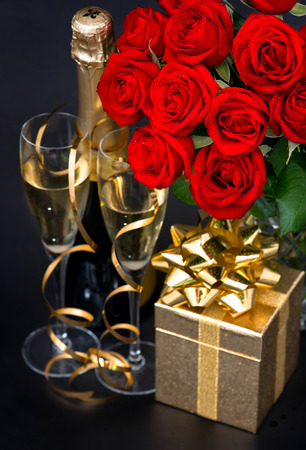 red roses, golden gift and and champagne on black St  Valentine photo