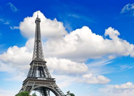 la tour eiffel: Eiffel Tower  La Tour Eiffel  against cloudy blue sky  Champ de Mars, place of interest in Paris, Europe