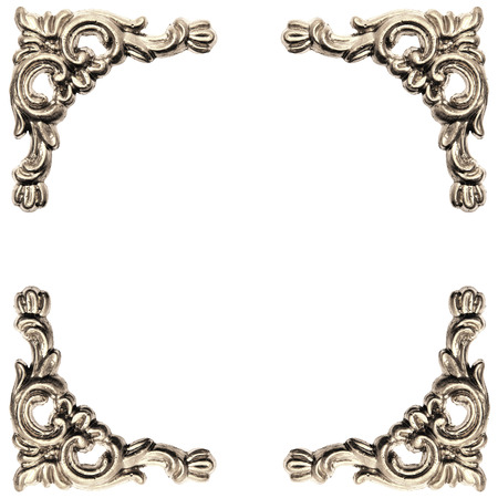 silver colored elements of baroque carved frame on white background with clipping path