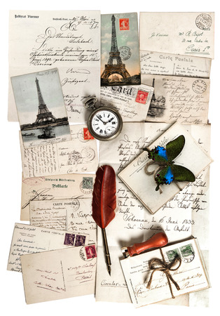 old letters, accessories and postcards  sentimental vintage travel background with antique clock, feather pen and butterfly photo