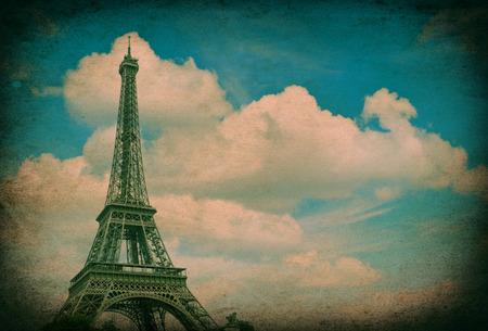 la tour eiffel: Eiffel Tower  La Tour Eiffel  against cloudy blue sky  Champ de Mars, place of interest in Paris, Europe  Vintage style picture