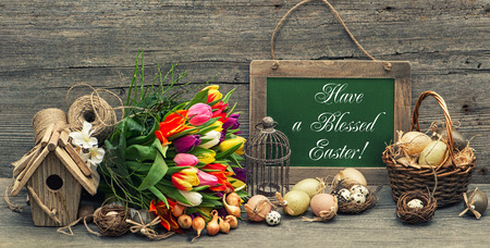 vintage easter decoration with eggs and tulip flowers  nostalgic festive background with sample text Have a Blessed Easter