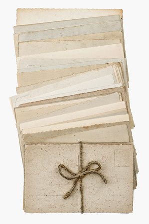 postcards isolated on white background  pile of old blank paper cards  vintage style picture photo