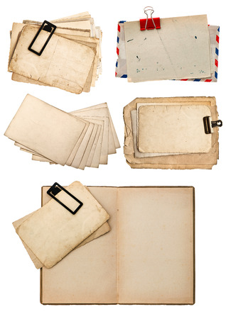 old book, vintage postcards and paper isolated on white background  retro design photo