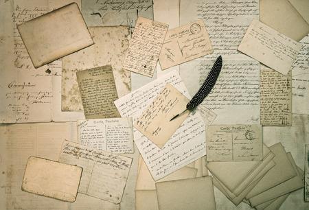 ephemera: ephemera  old letters, handwritings, vintage postcards and antique feather pen  nostalgic sentimental textured background
