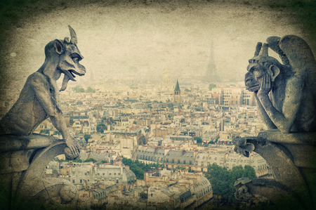 Stone demons gargoyle und chimera with Paris city on background  View from Notre Dame de Paris  Vintage style picture photo