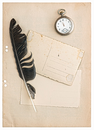 vintage papers and postcards isolated on white background. antique feather pen and clock photo